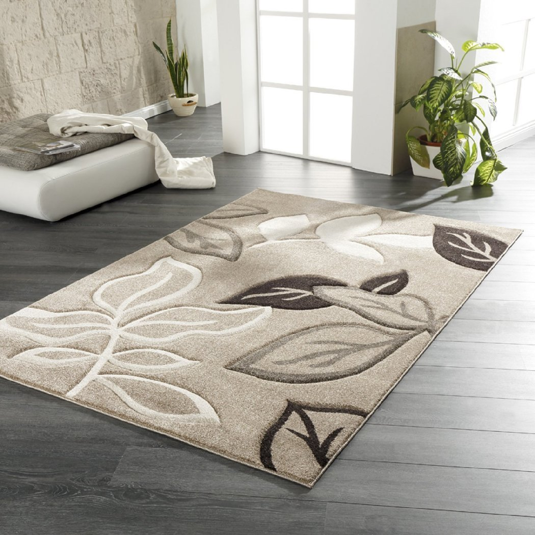 Beige rug with flowers pattern